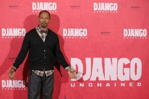 Jamie Foxx fashionably styled a plaid shirt, bow-tie and raw denim pants.