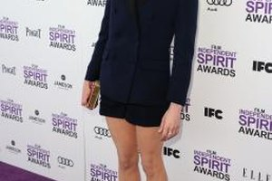 Actress michelle Williams pairs a blue blazer with matching shorts.