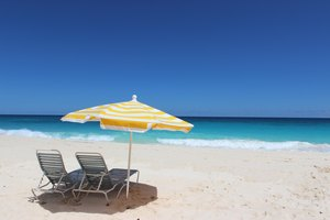 Beach Chairs and Yellow Striped Umbrella on Elbow Beach, Bermuda