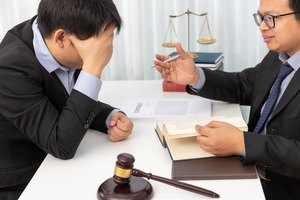 Concepts of law, Lawyer give legal advice to businessman about case in office.