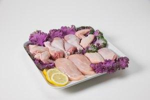 Cómo cocinar piernas y pechugas de pollo en el horno