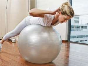 Exercises With an Exercise Ball for Lower Back Hyperextension