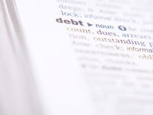How to Obtain a Loan While in a Debt Agreement