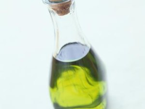 What Are the Health Benefits of Olive Oil Compared to Canola Oil?