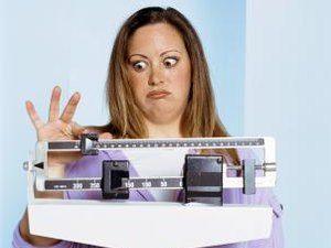 How Much Should a 180-pound Woman Eat to Lose Weight?