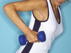 What Dumbbell Exercises for Women Make Your Back Smaller?