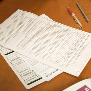 Does the Original Credit Card Company Have to Provide a Signed Contract in a Lawsuit?