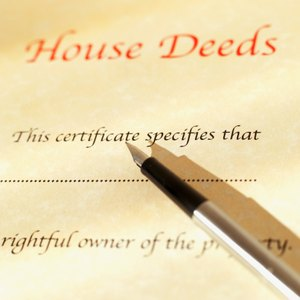 How to Convey 1/2 Interest in a Property Deed