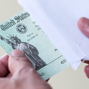 Can I Deposit My Paper Tax Refund Check in My Relative's Bank Account?
