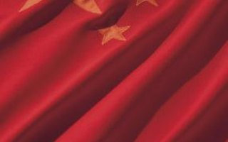What Does the Red Flag With the Yellow Star Symbolize About