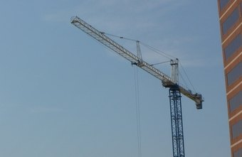 Tower crane operators often perform their jobs on construction sites.