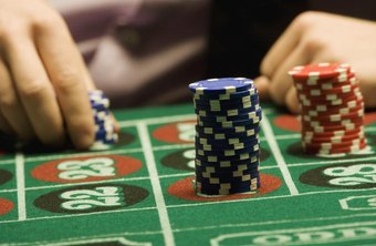 Gambling chips on a roulette table.