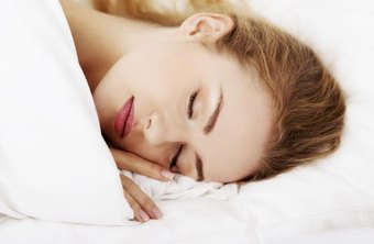 Close Up Of Woman Asleep In Bed