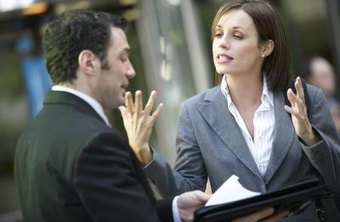 People talking outside the office about work is a method of communication.