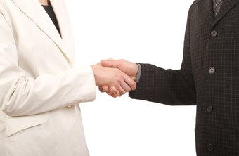 Business etiquette for greetings recommends a firm handshake when meeting someone.
