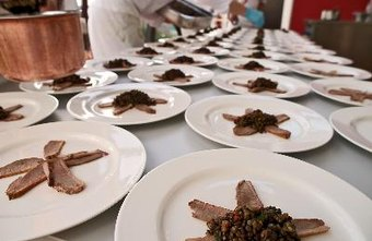 Caterers can prepare food for events large and small.
