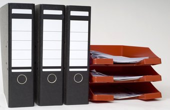 Using binders and filing trays can help you keep your desk organized and clutter-free.