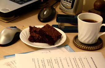 Eating at your desk can save time but may not be healthy.