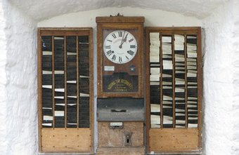 Employees punch the time clock with a timecard.