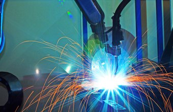 Robots perform precise welding work in industrial environments.