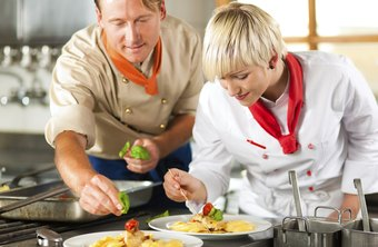 Apprentices learn from experienced chefs.
