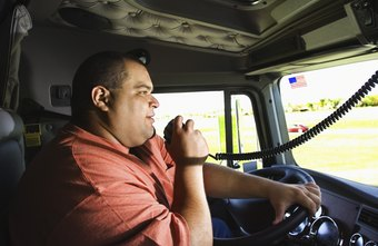 Long-distance truckers communicate by radio.