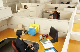 Cubicles and workstations clearly define personal space.