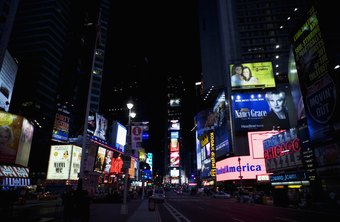 Advertising exposure is displayed in neon in Times Square in New York, NY.