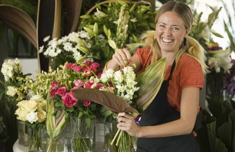 Florists brighten a customer's day with a decorative arrangement.