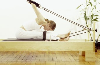Ropes create a V shape, attaching the carriage to the frame of the reformer.