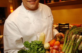 A chef displays locally grown ingredients.