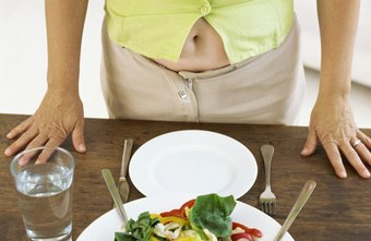 In addition to exercise, healthy eating habits can flatten your tummy.