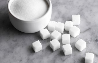 Sugar is included in total carbs and listed separately on the label.