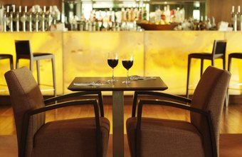A glass of wine enjoyed in a renovated bar starts the dining experience off on the right note.