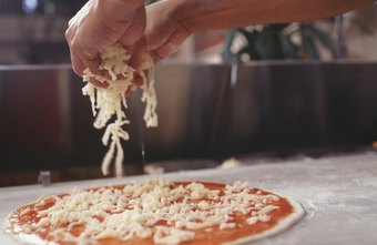 Preparing pizzas is just one of the many responsibilities of a pizza maker.