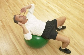 Ball crunches increase the challenge of a traditional core-strengthening exercise.