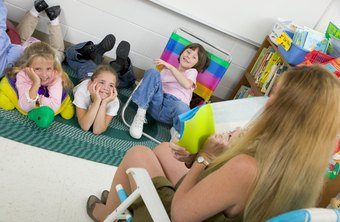 Preschool teachers often read stories to groups of children.