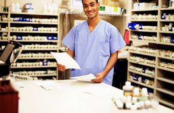 Pharmacy techs examine patient records when filling prescriptions.