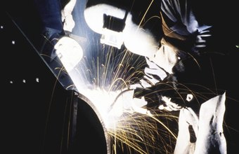 Welders wear heavy equipment to protect against sparks and molten metal.