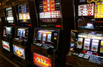 Casino guards monitor patrons and employees to prevent cheating.