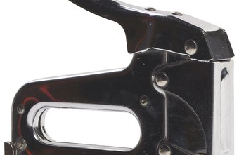 Use the latch at the back of the staple gun to insert and remove staples.