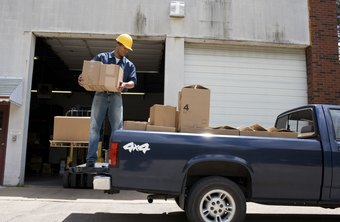 Professionals with an embarkation logistics background oversee loading of goods into vehicles.