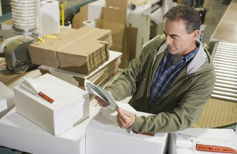A warehouse or logistics manager oversees warehouse employee teams.