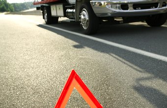A clearly marked safety zone helps protect tow truck drivers from oncoming traffic.