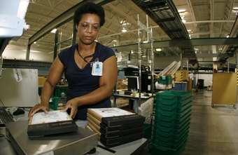 A worker sends products on their way at an Amazon fulfillment center.
