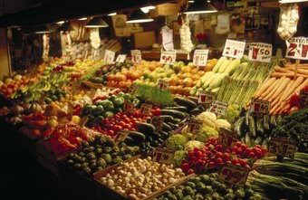The produce manager designs attractive displays in the store.
