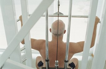 Use a cable machine to perform the lat pulldown.