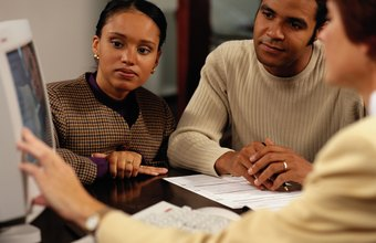 Loan officers collect income and credit information to approve mortgages.