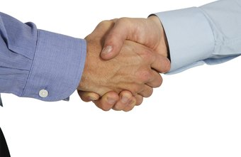 American business people shake hands when they meet.