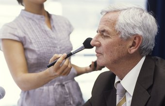 Makeup artists help politicians prepare for the camera.